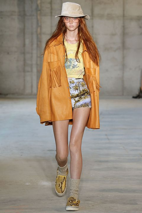 Fashion model, Clothing, Fashion, Fashion show, Runway, Street fashion, Yellow, Footwear, Outerwear, Shorts,
