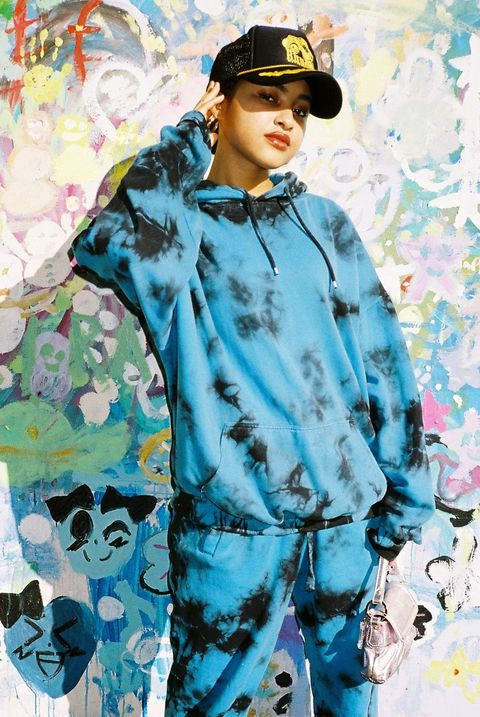 Sleeve, Headgear, Costume accessory, Art, Turquoise, Street fashion, Aqua, Painting, Visual arts, Costume,