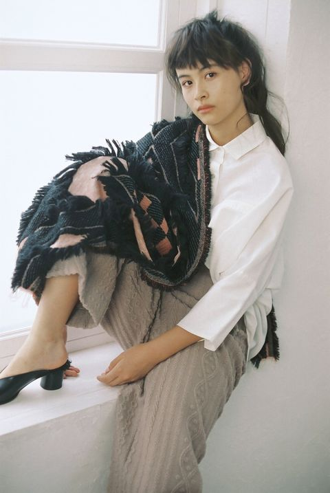 Collar, Textile, Shoe, Fashion, High heels, Black hair, Foot, Knee, Fur, Sandal,