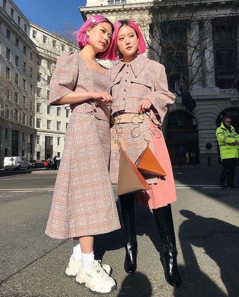 Street, Street fashion, High-visibility clothing, Headpiece, Pedestrian, One-piece garment, Costume, Peach, Hair accessory, Vintage clothing,