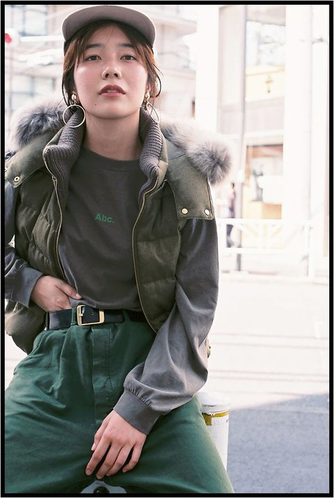 Green, Snapshot, Jacket, Outerwear, Fashion, Human, Street fashion, Coat, Photography, Sitting,