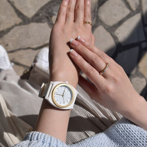Wrist, Hand, Analog watch, Finger, Watch, Nail, Arm, Fashion accessory, Material property, Jewellery,