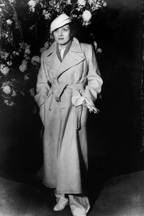 Photograph, Hat, Collar, Formal wear, Overcoat, Blazer, Vintage clothing, Retro style, Trench coat, Sun hat,