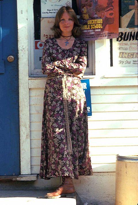 Clothing, Blue, Dress, Door, Street fashion, One-piece garment, Day dress, Necklace, Home door, Door handle,