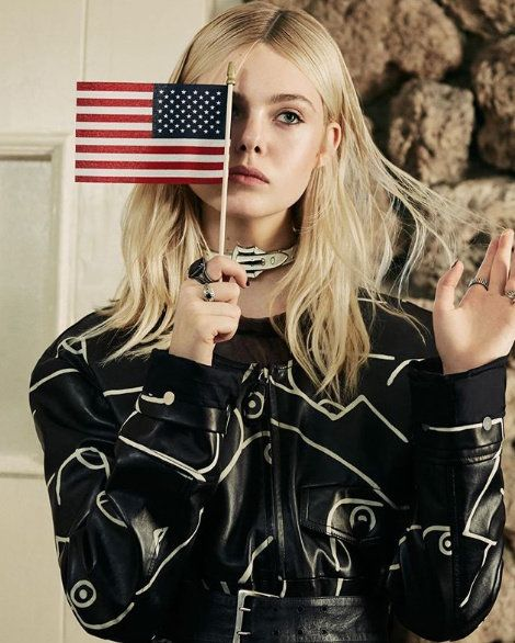 Lip, Sleeve, Jacket, Flag of the united states, Long hair, Blond, Street fashion, Flag, Brown hair, Button,