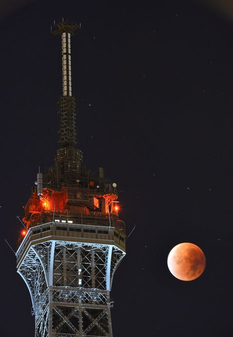 Night, Tower, Lunar eclipse, Sky, Celestial event, Astronomical object, Technology, Moon, Space, Midnight,