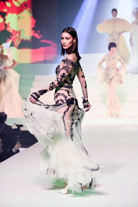Human, Fashion show, Sleeve, Shoulder, Runway, Waist, Fashion model, Style, Dress, Costume design,
