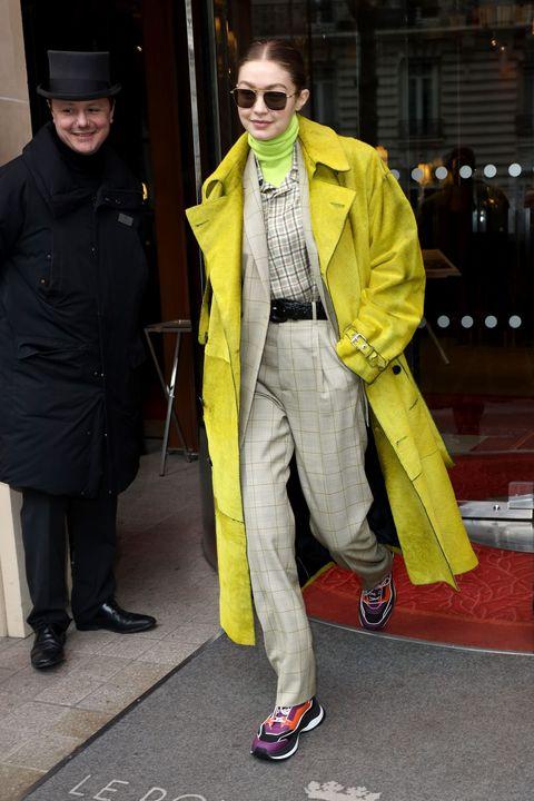 Eyewear, Footwear, Coat, Trousers, Jacket, Outerwear, Sunglasses, Style, Street fashion, Hat,