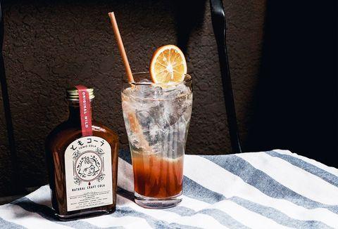Fluid, Liquid, Citrus, Bottle, Drink, Alcohol, Alcoholic beverage, Barware, Distilled beverage, Glass bottle,
