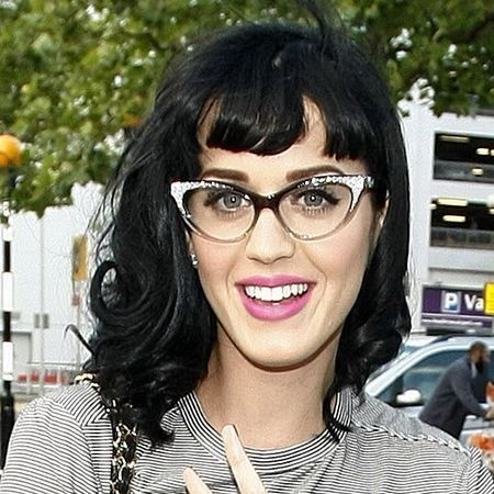 Eyewear, Vision care, Finger, Glasses, Hairstyle, Wrist, Bangs, Black hair, Fashion accessory, Street fashion,
