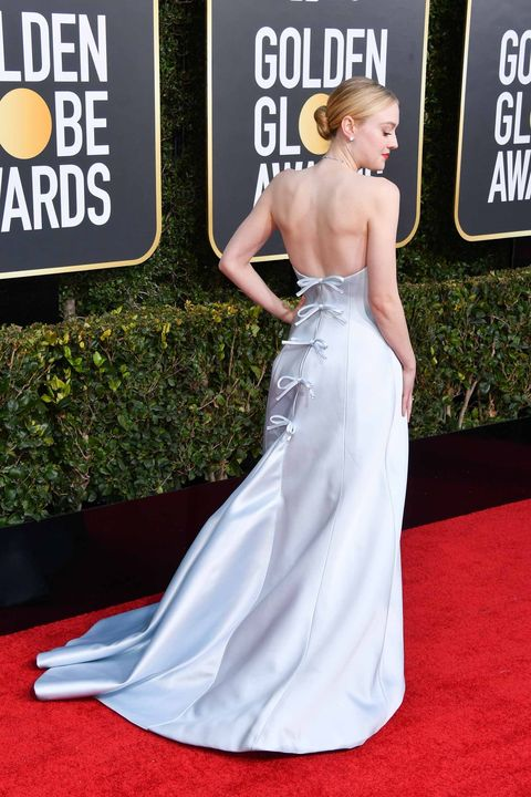 Red carpet, Dress, Gown, Carpet, Clothing, Shoulder, Flooring, Premiere, Hairstyle, A-line,