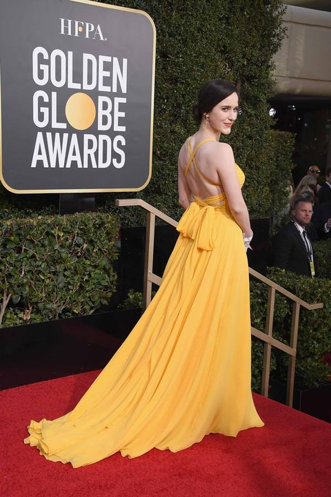 Red carpet, Dress, Carpet, Yellow, Clothing, Gown, Shoulder, Flooring, Fashion, Premiere,