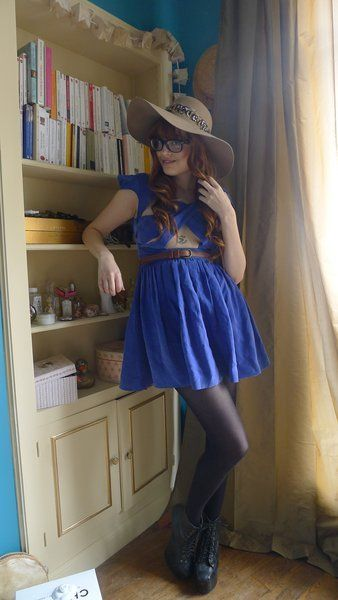 Clothing, Blue, Leg, Hat, Dress, Shoulder, Textile, Joint, Shelf, Fashion accessory,