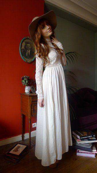 Dress, Shoulder, Hat, Room, Formal wear, Headgear, One-piece garment, Waist, Costume accessory, Gown,