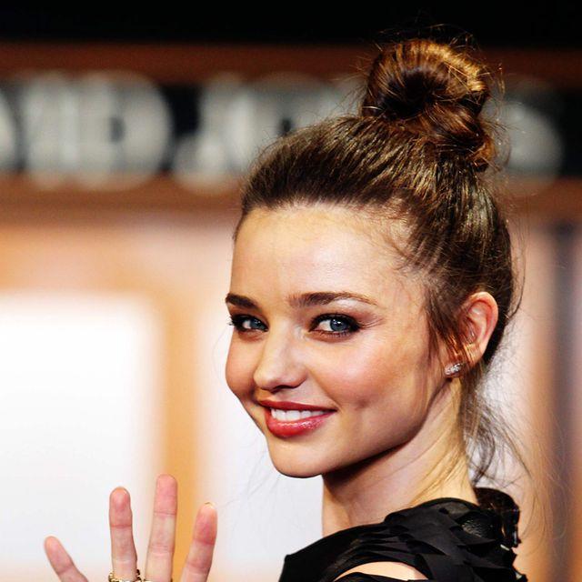 Finger, Hairstyle, Style, Eyelash, Fashion, Earrings, Fashion model, Gesture, Brown hair, Model,