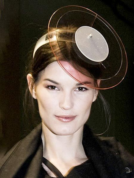 Lip, Hairstyle, Eyebrow, Style, Headgear, Costume accessory, Portrait, Earrings, Costume hat, Eye liner,