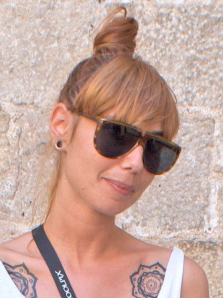 Eyewear, Glasses, Ear, Vision care, Hairstyle, Sunglasses, Chin, Shoulder, Style, Earrings,