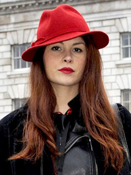Clothing, Nose, Lip, Hairstyle, Chin, Hat, Red, Jacket, Style, Headgear,