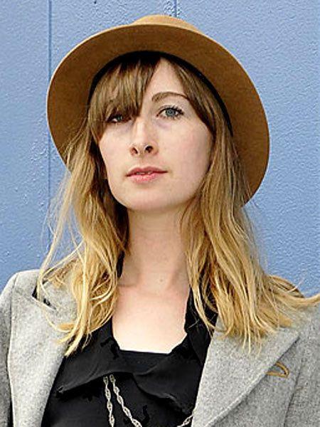 Lip, Hat, Hairstyle, Collar, Chin, Formal wear, Style, Headgear, Costume accessory, Blazer,