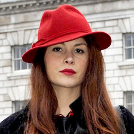 Clothing, Lip, Hairstyle, Chin, Hat, Red, Style, Jacket, Headgear, Street fashion,