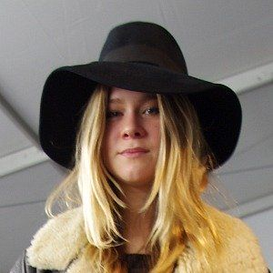 Clothing, Lip, Hat, Brown, Hairstyle, Textile, Outerwear, Jacket, Style, Sun hat,