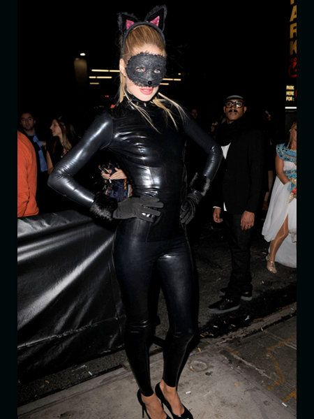 Latex, Masque, Fashion, Costume accessory, Costume, Fictional character, Leather, Mask, Latex clothing, Spandex,