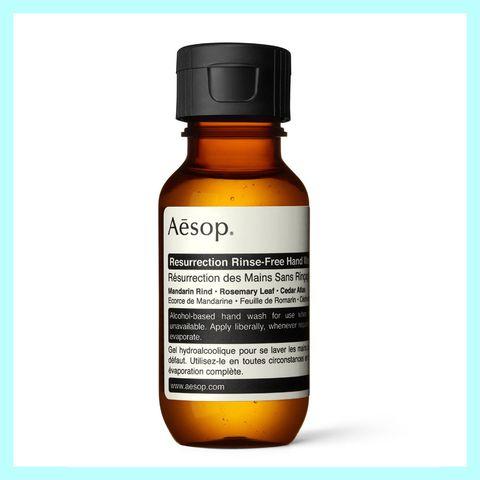 Liquid, Fluid, Product, Brown, Bottle, Amber, Orange, Logo, Tan, Bottle cap,