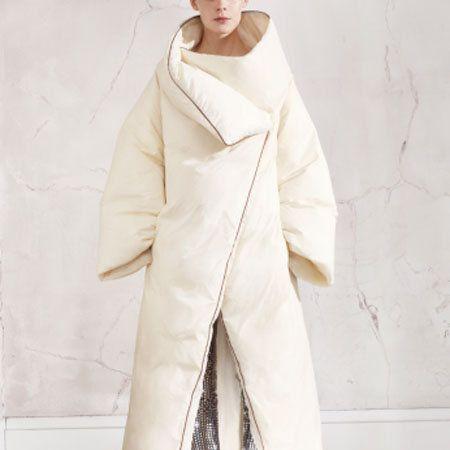 Sleeve, Shoe, Textile, Outerwear, Collar, Fashion, Costume design, Beige, Fashion model, Overcoat,
