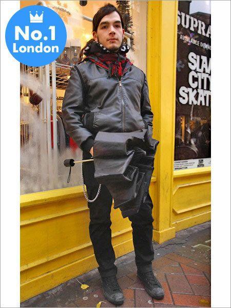 Jacket, Street fashion, Leather, Signage, Boot, Leather jacket, Advertising, Sign, Top, Overcoat,