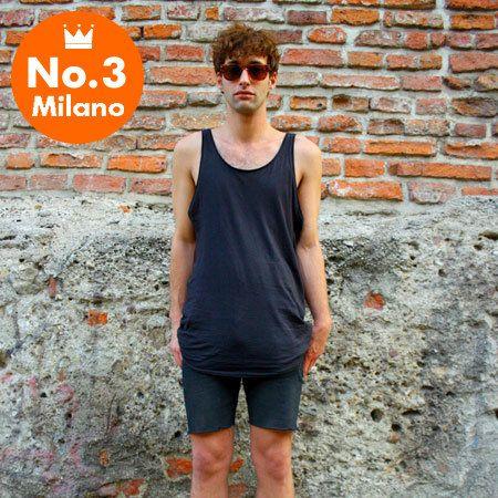 Clothing, Sleeveless shirt, Sunglasses, Street fashion, Brick, Goggles, Active tank, Undershirt, Stone wall, Brickwork,