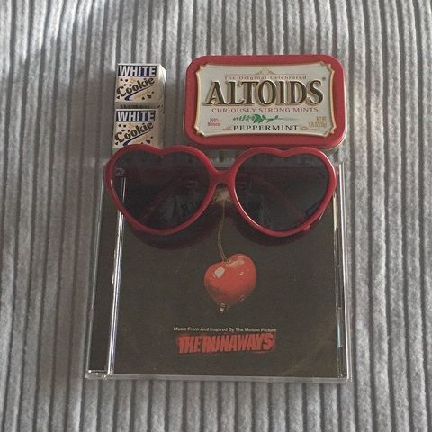 Eyewear, Vision care, Glasses, Goggles, Text, Sunglasses, Red, Eye glass accessory, Advertising, Costume accessory,
