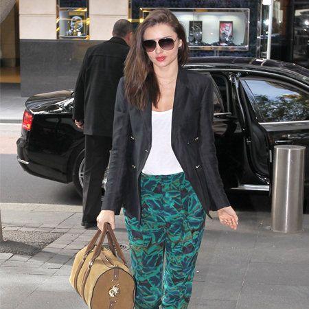 Clothing, Eyewear, Vision care, Brown, Automotive design, Shoulder, Bag, Textile, Sunglasses, Outerwear,