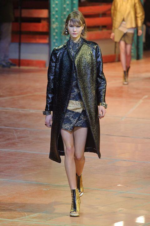 Leg, Fashion show, Human body, Runway, Joint, Human leg, Outerwear, Jacket, Style, Fashion model,