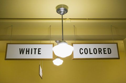 Yellow, Lighting, Property, Text, Wall, Ceiling fixture, Ceiling, Lighting accessory, Light fixture, Signage,