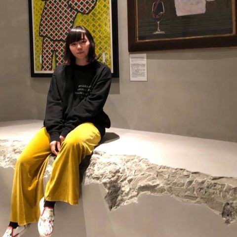 Yellow, Sitting, Picture frame, Comfort, Knee, Sandal, Foot,