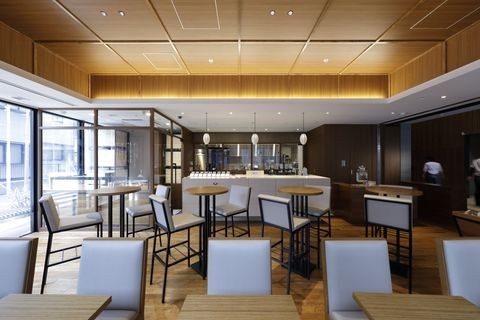 Building, Room, Interior design, Property, Restaurant, Architecture, Furniture, Table, Dining room, Ceiling,