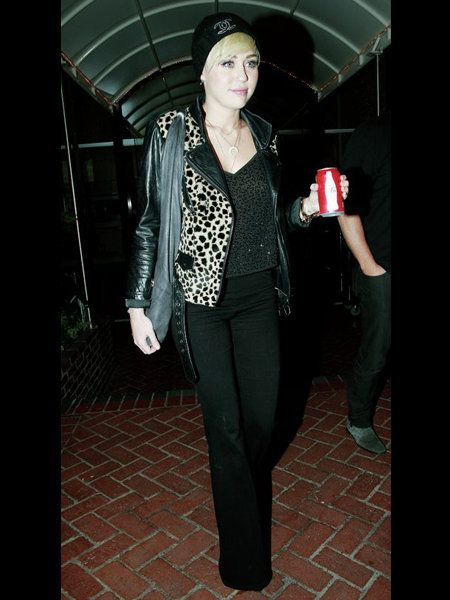 Standing, Style, Street fashion, Black, Jacket, Flash photography, Leather, Top, Drinking, Leather jacket,