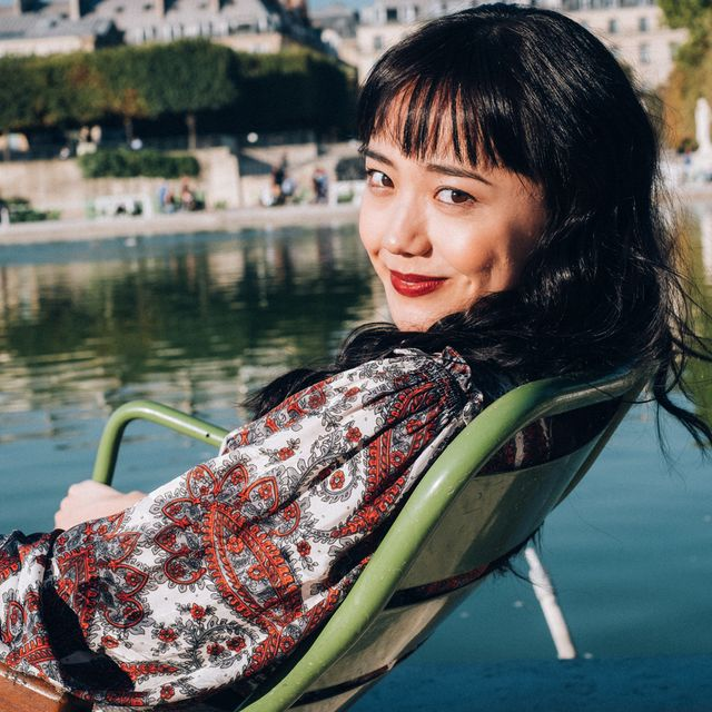 Hair, Beauty, Black hair, Hairstyle, Smile, Sitting, Photography, Spring, Leisure, Tree,