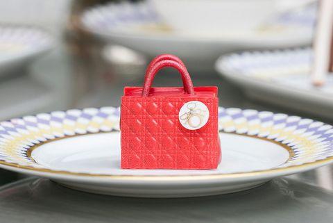 Red, Design, Fashion accessory, Food, Tableware, Serveware, Plate, Dishware, Handbag, Bag,