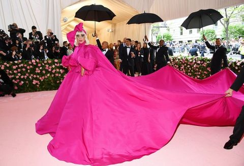 Pink, Dress, Clothing, Red carpet, Gown, Carpet, Magenta, Flooring, Fashion, Event,