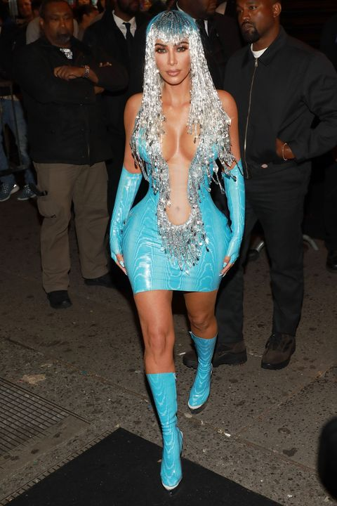 Fashion model, Clothing, Fashion, Thigh, Turquoise, Leg, Hairstyle, Haute couture, Electric blue, Transparent material,
