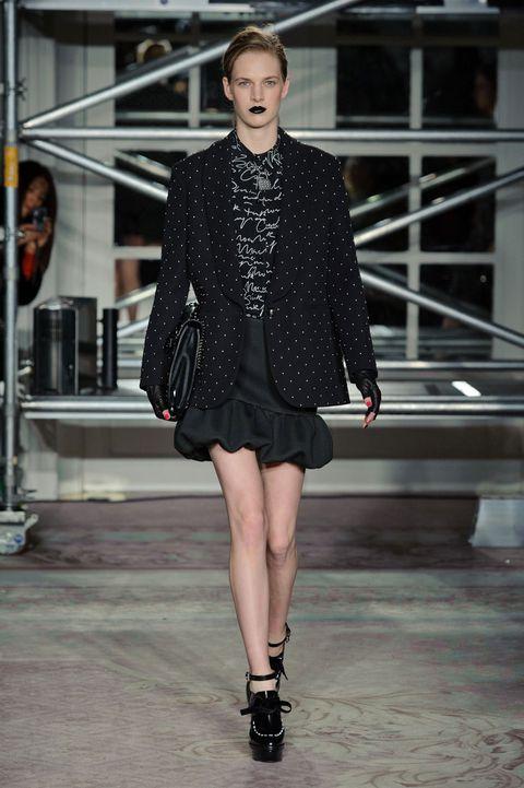 Shoulder, Fashion show, Joint, Human leg, Outerwear, Fashion model, Style, Runway, Collar, Street fashion,