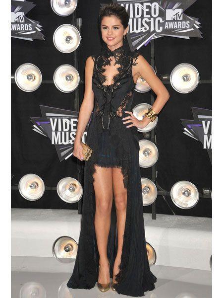 Human, Human body, Dress, Fashion accessory, Premiere, High heels, Fashion model, Cocktail dress, Little black dress, One-piece garment,