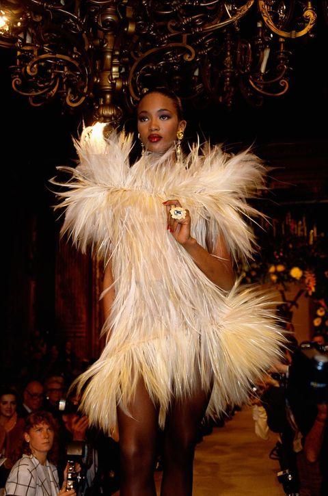 Fashion, Fashion show, Fur clothing, Feather, Fur, Fashion design, Runway, Fashion model, Haute couture, Model,