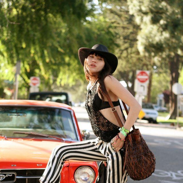 Automotive design, Hat, Grille, Classic car, Car, Dress, Street fashion, Fashion accessory, Personal luxury car, Costume accessory,