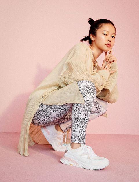 Sleeve, Human body, Shoe, Textile, Sitting, Fashion, Fashion model, Sandal, Knee, Beige,