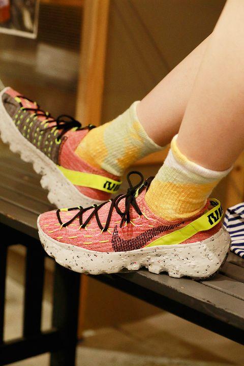 Yellow, Human leg, Pink, Orange, Athletic shoe, Carmine, Fashion, Running shoe, Walking shoe, Sneakers,