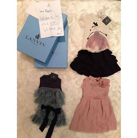 Dress, Costume accessory, Pattern, Fashion, Day dress, Embellishment, One-piece garment, Handwriting, Costume design, Peach,