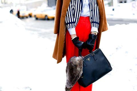 Textile, Bag, Winter, Street fashion, Shoulder bag, Luggage and bags, Pocket, Snow, Fur, Strap,