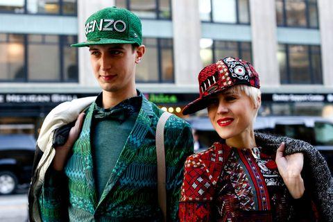 Green, Pattern, Cap, Headgear, Street fashion, Fashion accessory, Fashion, Baseball cap, Necklace, Costume,